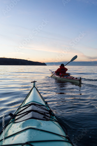 Ocean Kayaking during Sunset. Taken in Vancouver, British Columbia, Canada. Concept: sport, adventure, fitness, vacation, holiday.