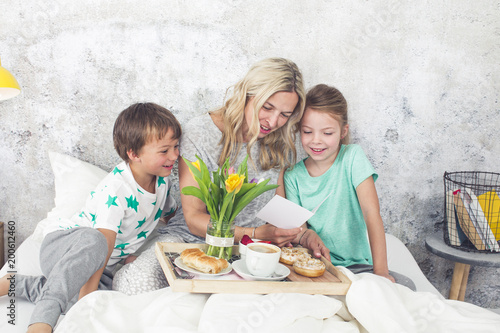 Mother´s Day - children surprise their mum with breakfast in bed