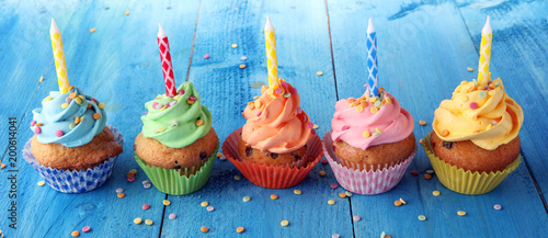 Tasty cupcakes on wooden background Wallpaper Mural