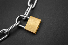 Golden Padlock With Chain On B...