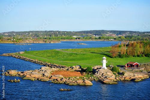 Fotografie, Obraz  Leuchtfeuer Göteborg mit Landschaft