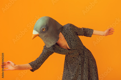 Woman wearing pigeon mask and going to run Canvas Print
