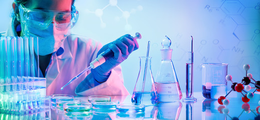 Chemistry Laboratory - Woman With Pipettes And Test Tubes