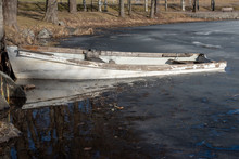 A Little Boat In Water And Ice...