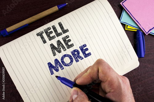 Photo Conceptual hand writing showing Tell Me More