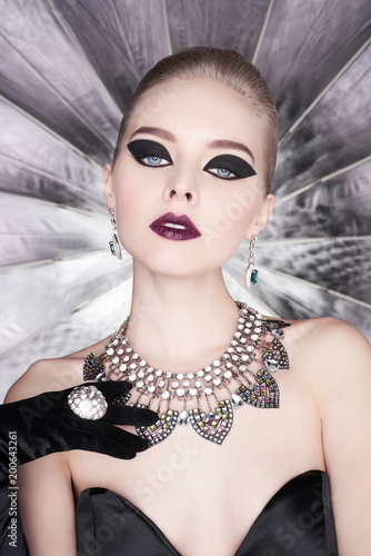 Poster womenART Woman with bright makeup and with set jewelry
