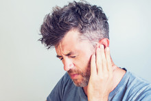 Man With Earache Is Holding Hi...