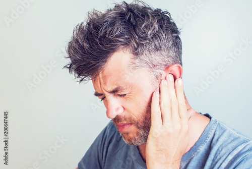 Canvastavla Man with earache is holding his aching ear body pain concept