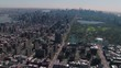 New York City helicopter aerial skyline of Central Park and Midtown Manhattan, flying over East Harlem