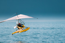 Motorized Hang Glider With Muslim Woman Take Off Frow Sea In Sunny Summer Day