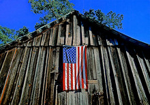 View Up At American Flag On Barn