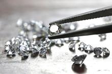 Brilliant Cut Diamond Held By ...