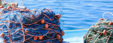 Stacks Of Fishing Nets On Blue...