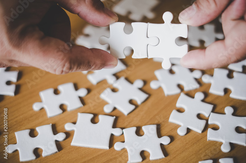 Fototapety, obrazy: Shot of hand holding puzzle. Symbol for connection, teamwork, together, success, strategy