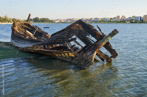 Old skeleton of a destroyed and burned boat on the bank of the Seixal Bay Canvas Print