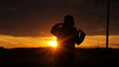 figure on a sunset background, sun and a man, a man in the dark, poses