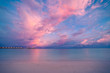Amazing Maldives beach sunset, sky and clouds and luxury water villas