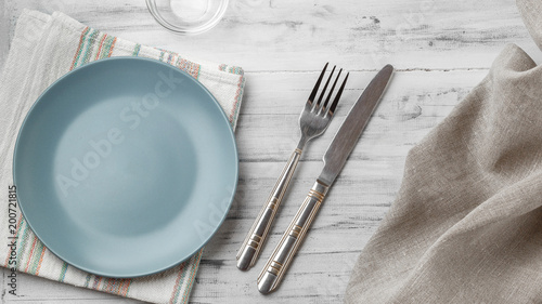 Empty plate on light wooden background