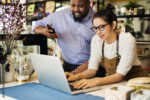 Busibess owner is using laptop