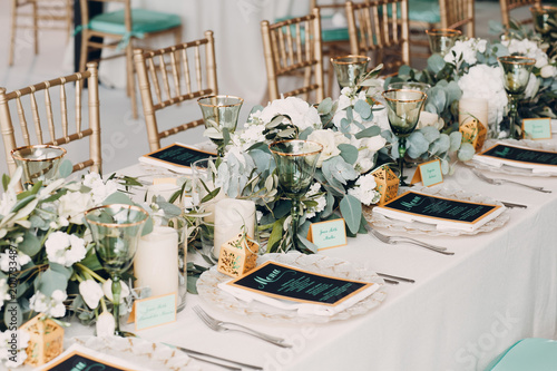 Fototapeta Wedding table decor in white green tones obraz