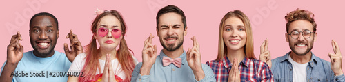 Photo  Collage photo of five different people have desired look, cross fingers and keep palms together, hope for good luck at exam, isolated over pink background