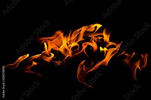 Photo sur Toile Feu, Flamme Fire flames on black background. Fire is the oxidation of the material rapidly in the exothermic combustion process, which releases heat, light.