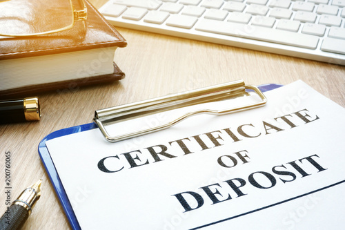 Fototapeta Certificate of deposit and pen on a desk.