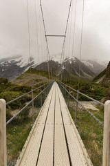 Panel Szklany 3D Suspension bridge and wooden path in to national park New Zealand natural landscape background