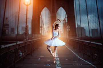 Fototapeta Taniec / Balet Ballet dancer dancing on the bridge in the evening