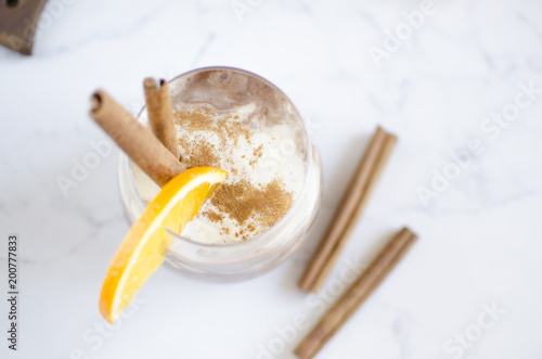Canvas Prints Beer / Cider Chocolate-vanilla mousse with an orange slice on a white marble table