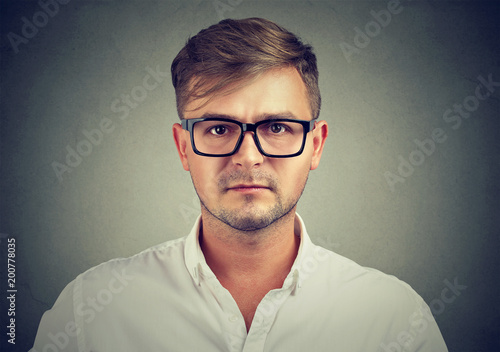 Fotografering  Serious man in glasses and shirt