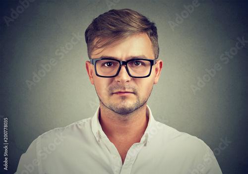 Fotografia, Obraz  Serious man in glasses and shirt