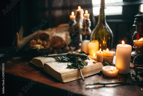 Canvas Print Witchcraft, dark magic, candles with ritual book