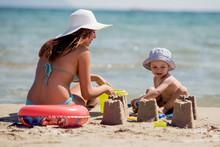 Mom And Boy Play On Tropical Beach
