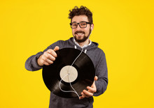 Excited Hipster Man With Vinyl Record And Earphones