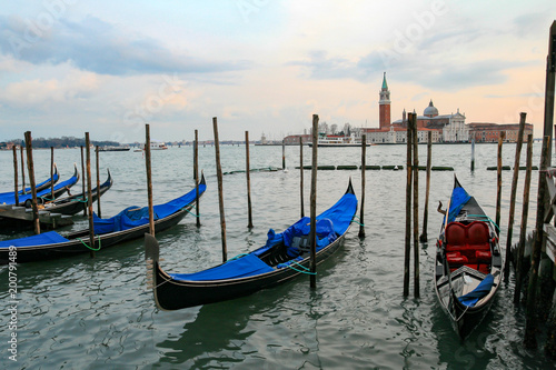 Spoed Foto op Canvas Gondolas Gondolas in Venice - sunset with San Giorgio Maggiore church.