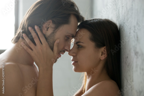 Photographie  Romantic beautiful couple face to face, loving millennial affectionate woman tou