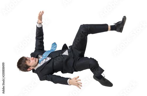 Obraz Businessman is falling down. Isolated on white background. - fototapety do salonu