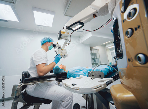 c21493e17b2 Eye surgery. A patient and surgeon in the operating room during ophthalmic  surgery. Vision