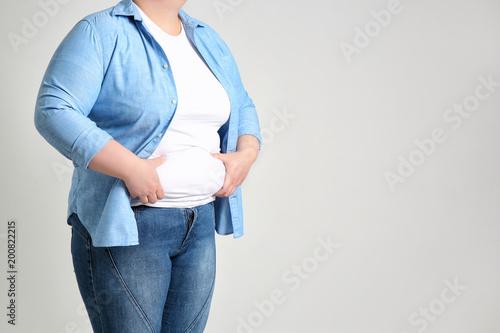 Obraz na plátne  Overweight woman on light background