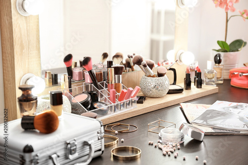 Photo  Table with cosmetics in modern makeup room