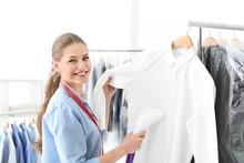 Young Woman Steaming Shirt At ...
