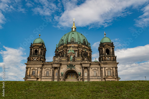 Photo  The cathedral of Berlin with a meadow in front