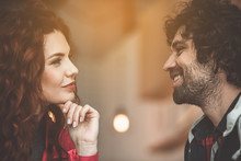 Cheerful Loving Couple Is Flirting And Smiling Indoors. Romantic Date Concept