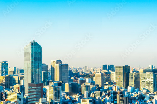 Aluminium Prints Asia business concept for real estate and corporate construction - panoramic urban city skyline aerial view under twilight sky and golden sun in hamamatsucho, tokyo, Japan