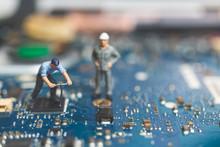 Miniature People : Worker Team Of Engineers Repairing Keyboard Computer Laptop