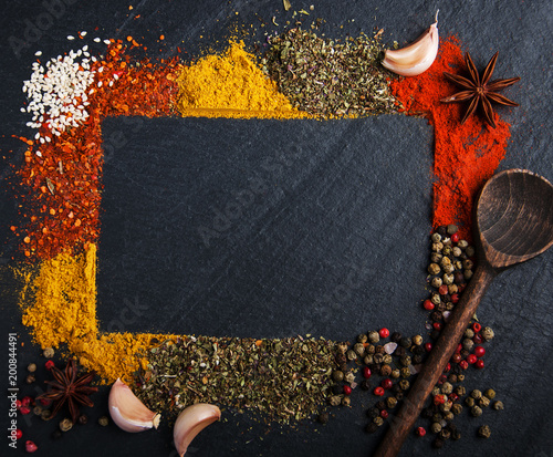 Different kind of spices on a black background