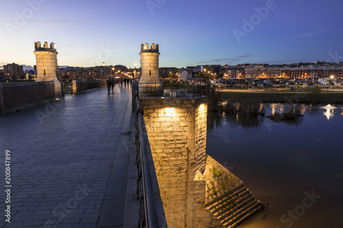 Badajoz, Spain. Sunset at river Guadiana and Puente de Palmas bridge