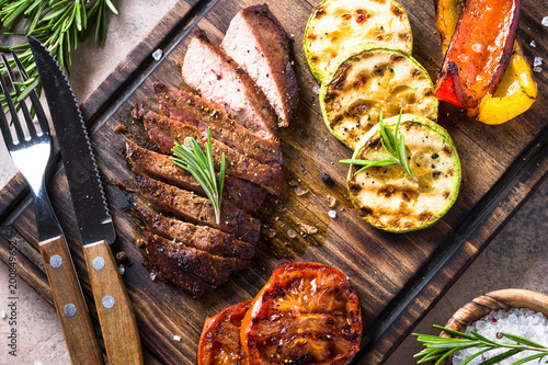 Tuinposter Grill / Barbecue Barbecue dish. Beef steak and grilled vegetables top view.