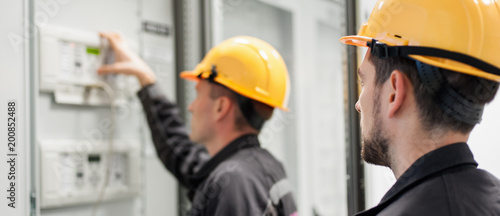 Field service crew testing electronics or inspecting electrical installation sys Wallpaper Mural